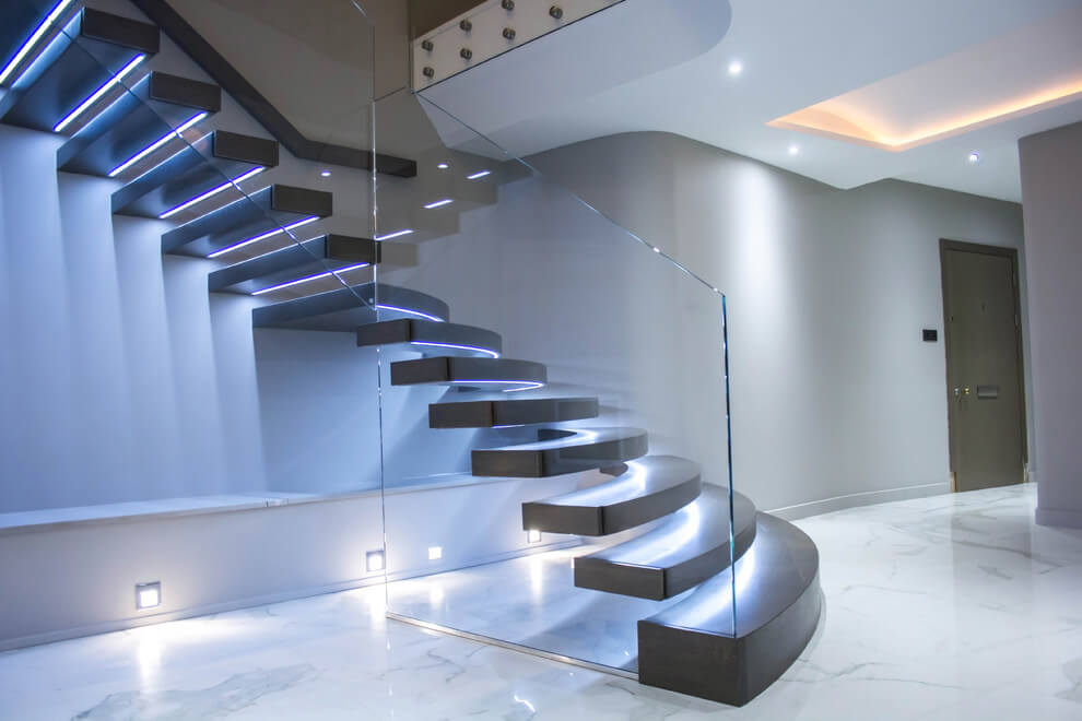 Illuminated Floating Staircase With Huge Curved Treads