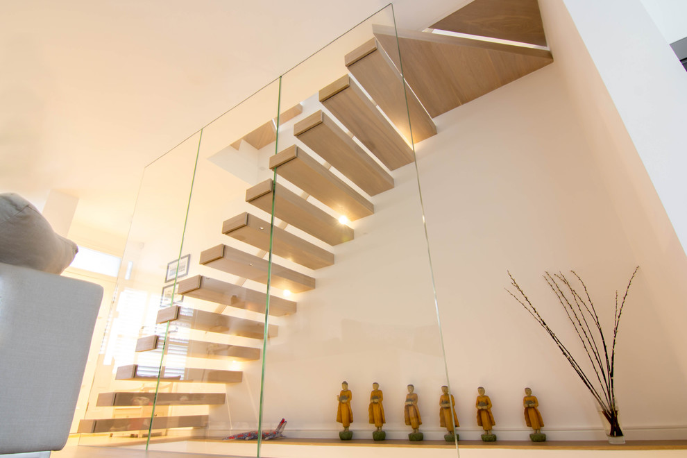 Elegant cantilever staircase features oak-clad treads